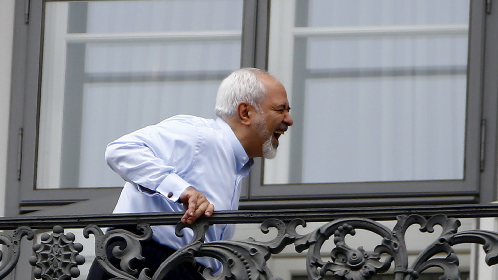 Iranian Foreign Minister Zarif stands on the balcony of Palais Coburg, the venue for nuclear talks, in Vienna